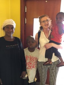 Book Oscars - Mag Kirwan with cancer patients at Hospice Africa Uganda