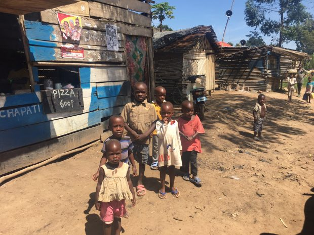 Mag Kirwan with children at Hospice Africa Uganda